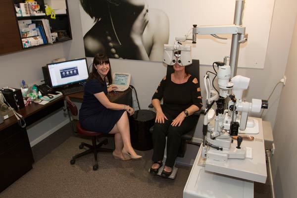 Celia Bloxsom performing an eye test at Eyeconic Optometry Southport